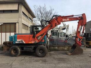 O&K MHCITY wheel excavator